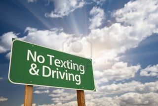 10577220-no-texting-and-driving-green-road-sign-with-dramatic-sky-clouds-and-sun